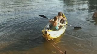 Father Pranks His Daughters On Inflatable Kayak - Video