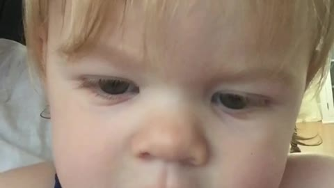 Cute Toddler  Is Infatuated With Her Image On A Smartphone