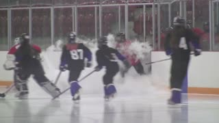 Hockey team slips on dry ice - Video
