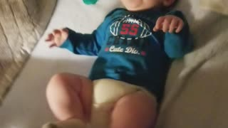 Baby laughs hystaricly at mom flipping diaper  - Video