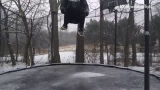 Kid back flips in snowy black trampoline lands on neck
