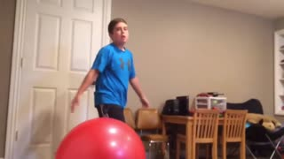 Boys Break Wall Playing With Exercise Balls - Video