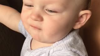 Baby boy can't handle stinky breath! - Video