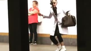 Guy white long coat dancing subway platform headphones  - Video