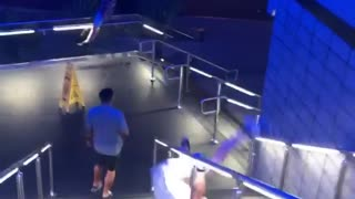 Three guys slide down stair rail - Video