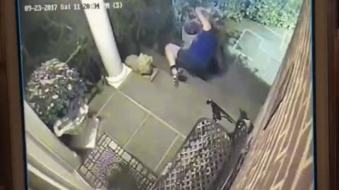 Security camera, woman falls down front porch stairs
