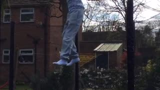 Kid blue shirt stripes trampoline backflip fail foot caught on net