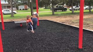 Mom knocks down kid on playground - Video