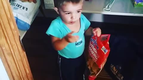 Sneaky Little Boy Eats Chips In The Pantry