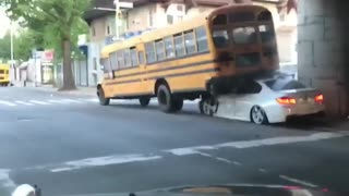 Crashed Car Under School Bus - Video
