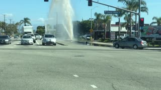 Busted Fire Hydrant Sprays Sky High at Intersection