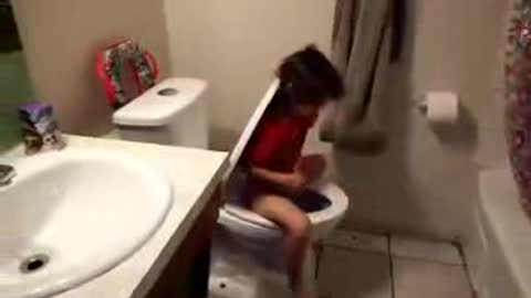 little girl has funny way of pooping