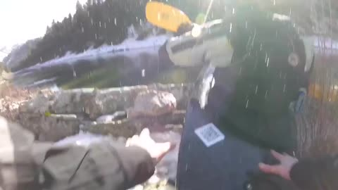 Man in yellow kayak falls into icy snow water