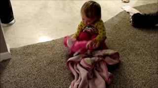 Toddler Cares for Baby Doll - Video