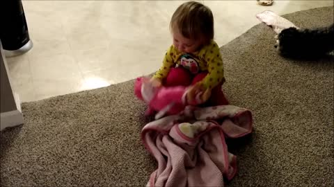 Toddler Cares for Baby Doll