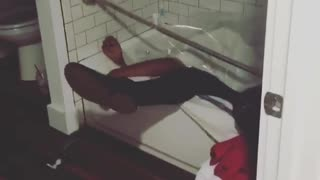 Drunk guy falls in shower curtain