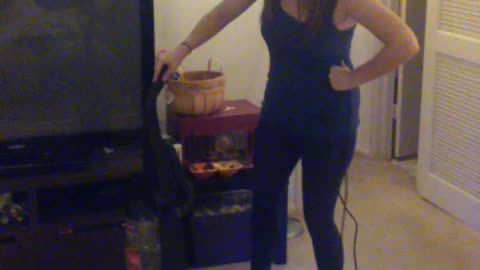 """Modern-Day Housewife"" Vacuums On Hover Board"