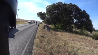 Driver Swerves Into Passing Motorcyclists - Video
