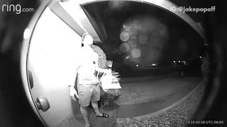 Front door security camera, guy holds cup of bud light beer to unlock door and drops beer