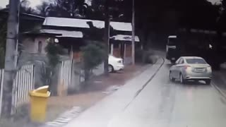 House-Towing Truck Nearly Wrecks