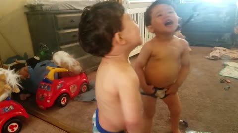 Super cute toddler boy reacts to putting his bare tummy against the mirror, but then...