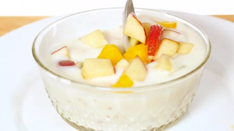 Bowl with yogurt served with chopped fruit
