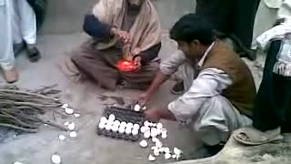 A person in Gujrat eating 36 eggs without boiling  - Video