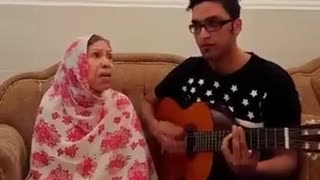 Mother and her son singing a traditional song