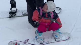 Baby isn't interesting in snowboarding - would rather nap instead!