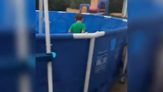 Collab copyright protection - little boy slips plastic pool - Video
