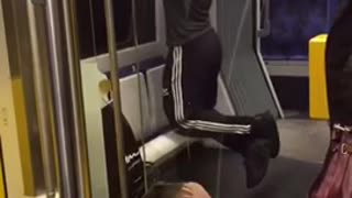 Man in black and white headphones pull ups on bus - Video