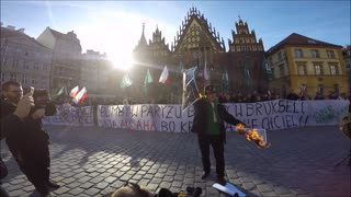 Burned photo of Angela Merkel Polish anti-immigrant demonstration April 2nd 2016 - Video