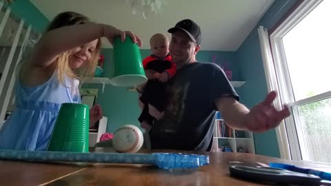 Four-Year-Old Baffled by Magic Ball Trick