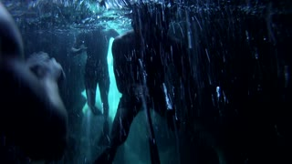 Swimming underneath a dark underwater cave