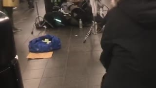 Little boy does the floss dance and the splits in subway station