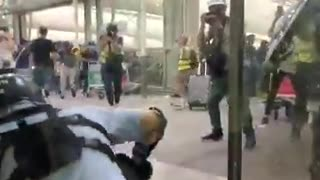 Police and protesters clash at Hong Kong Airport