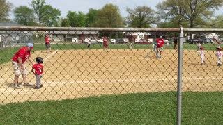 Coach Carries Tee-Ball Player Who Won't Run To First Base - Video
