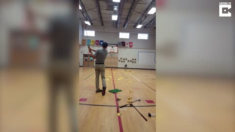 'What the butt': 8yo dumbstruck golf student so surprised by great trick shot he comes close to swearing