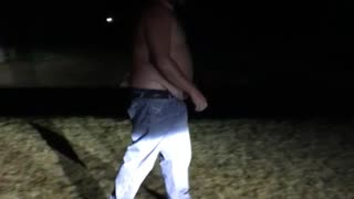 A guy runs into his shirtless friend