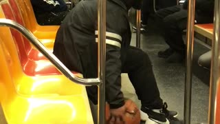 Man dribbles ball on subway train - Video