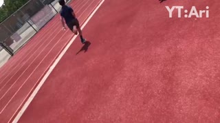 Skateboarding kid on track falls face first into high jump mat - Video