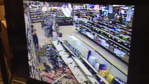 Retail Clerk Left With Big Mess After Shelving Unit Collapses In Front Of Her