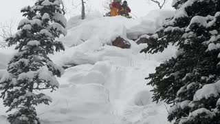 Guy skis down steep mountain and tumbles down, friends laugh