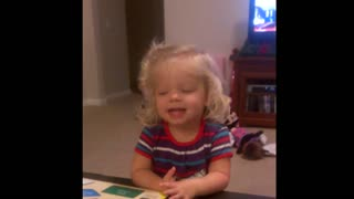 Little girl says sorry, I'm not sorry for ruining puzzle - Video