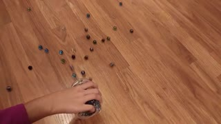 Marbles Thrown On A Wooden Flooring