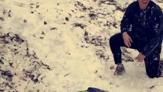 Beanie guy rides boogie board off snow ramp and faceplants