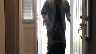 Black dog hugs man who comes thru door - Video