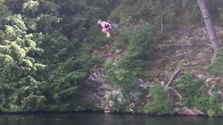 Guy does a front flip and belly flops in a lake from a ropeswing  - Video