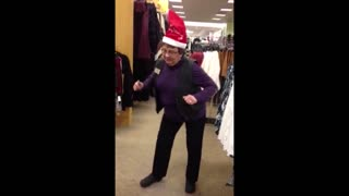 Woman busts a move in a singing santa hat - Video