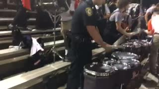 High School drumline gets huge surprise when cop shows up to play - Video
